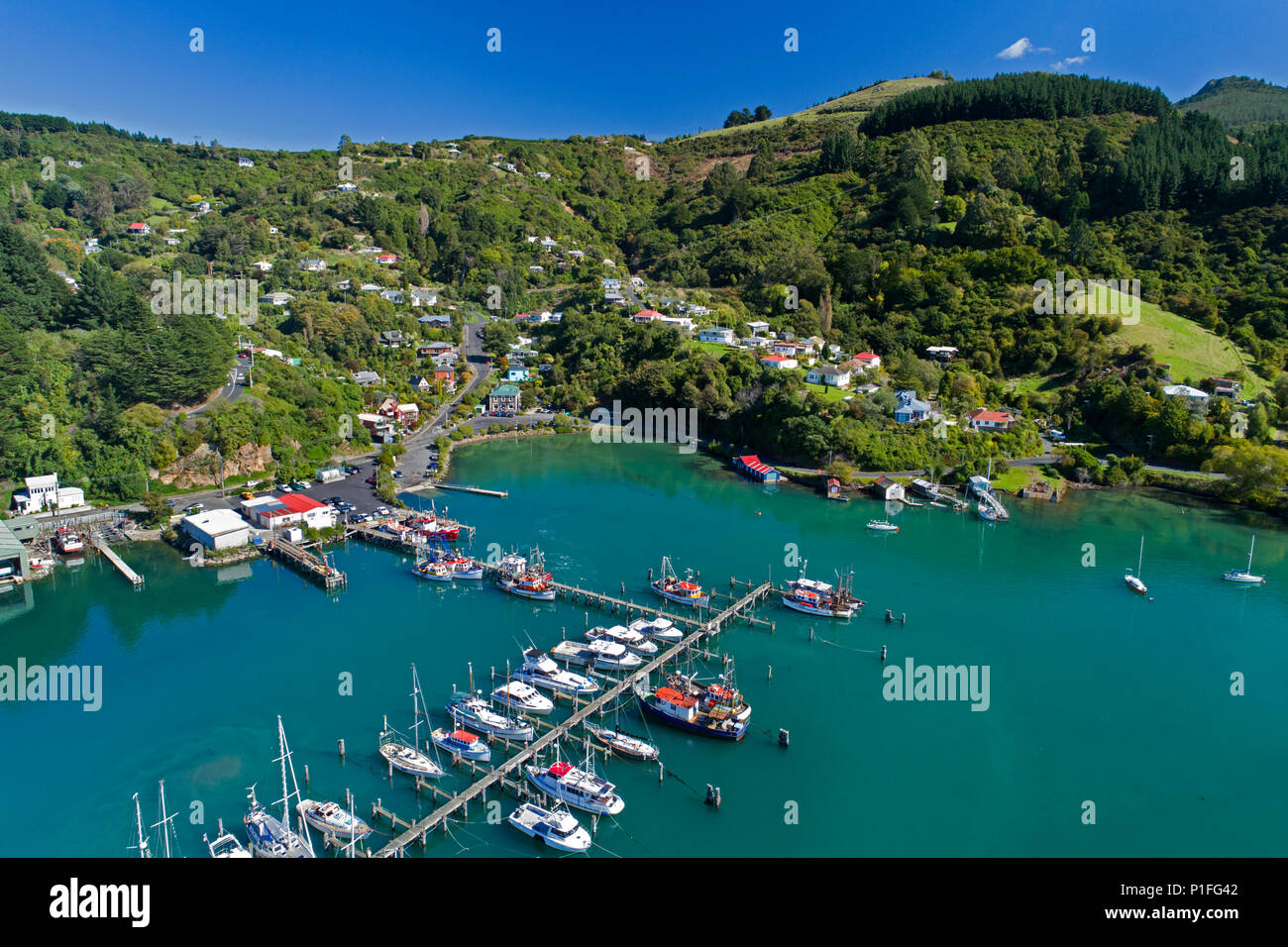 Fishing Boats at Carey's Bay Wharf and Otago Harbour, Port Chalmers, Dunedin, Otago, South Island, New Zealand - drone aerial - Stock Image
