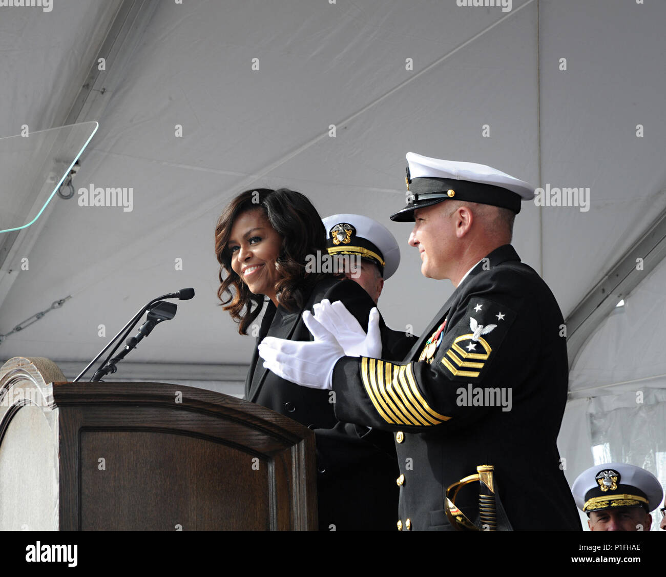 161029-N-HI707-293  GROTON, Conn. (Oct. 29, 2016) First Lady Michelle Obama announces 'Bring the Ship to Life' spurring its crew members to race across the brow and fall in formation aboard USS Illinois (SSN 786) during the commissioning ceremony on Naval Submarine Base New London, Oct. 29. USS Illinois is the U.S. Navy's 13th Virginia-Class attack submarine and the fourth ship named for the State of Illinois. (U.S. Navy photo by Chief Petty Officer Darryl I. Wood/Released) - Stock Image