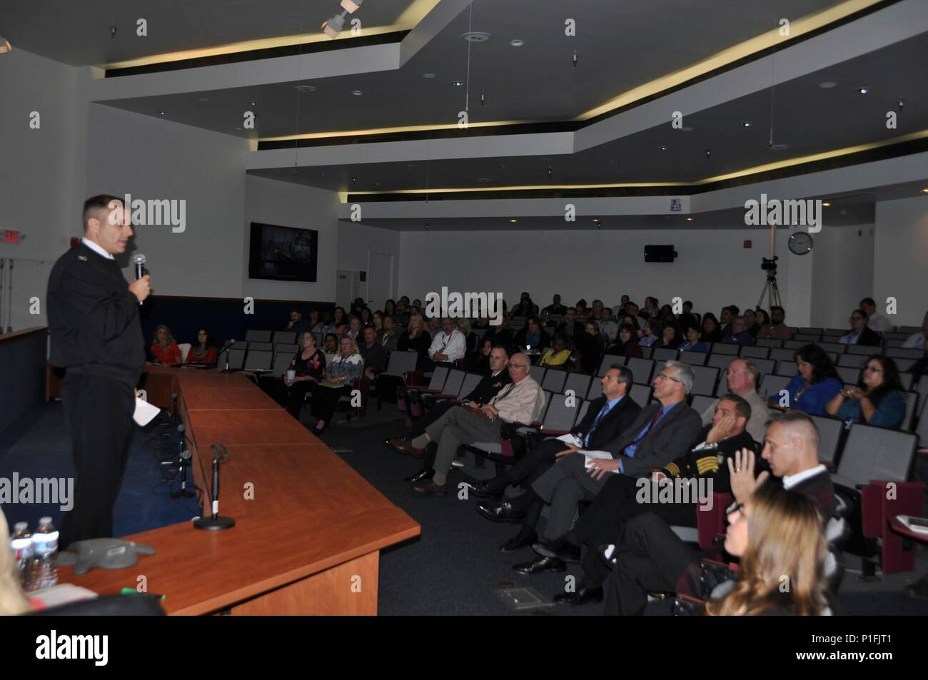 "PORT HUENEME, Calif. -- Chief Logistician, Capt. David Lockney, encourages the audience to ""Get in the Game"" during the Logistics Forum held in the Audiovisual Center, Oct. 26. - Stock Image"