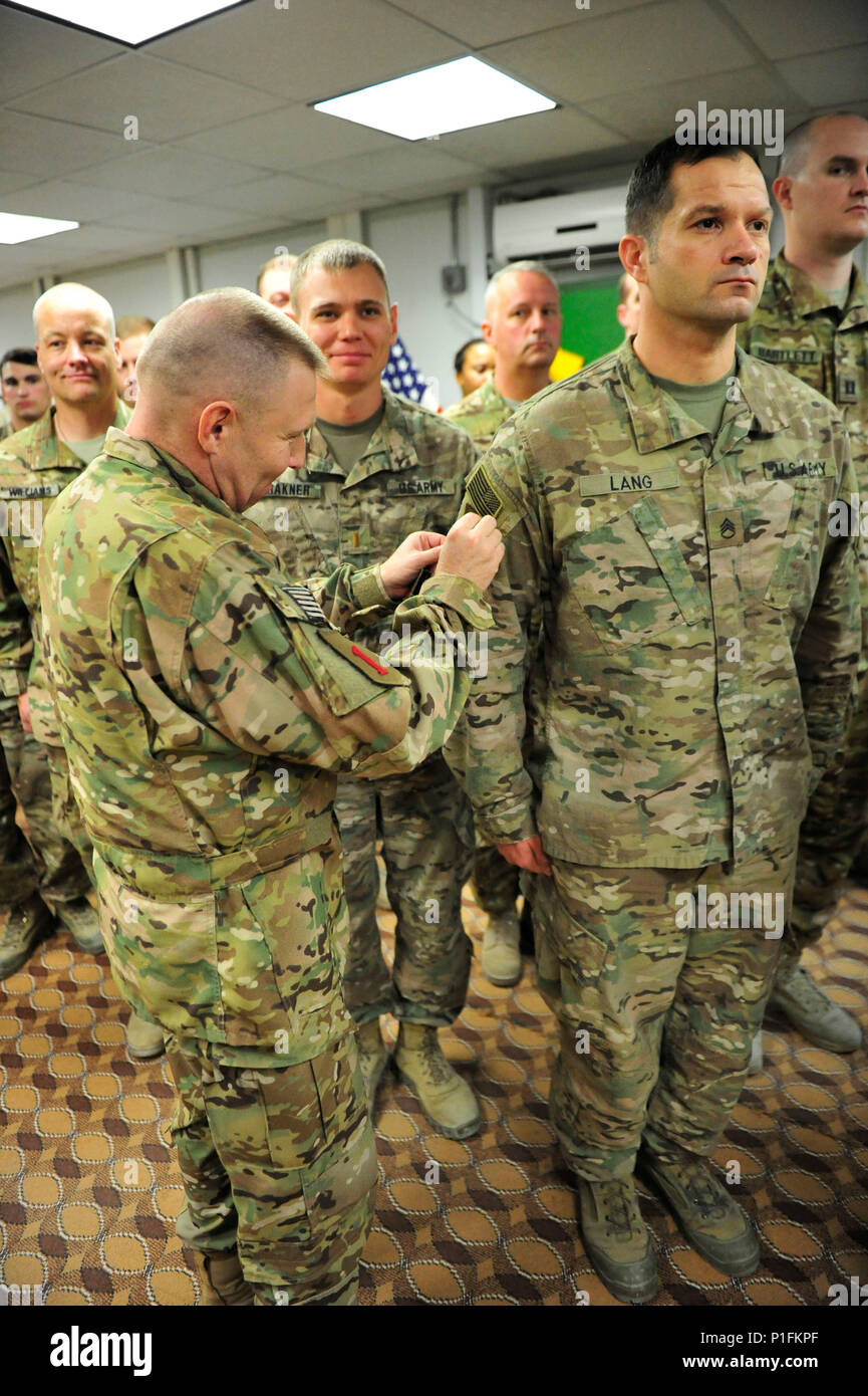 John M Cyrulik Commander Of 1st Combat Aviation Brigade Infantry Division Pins A Throwback Patch On Soldier During The Units