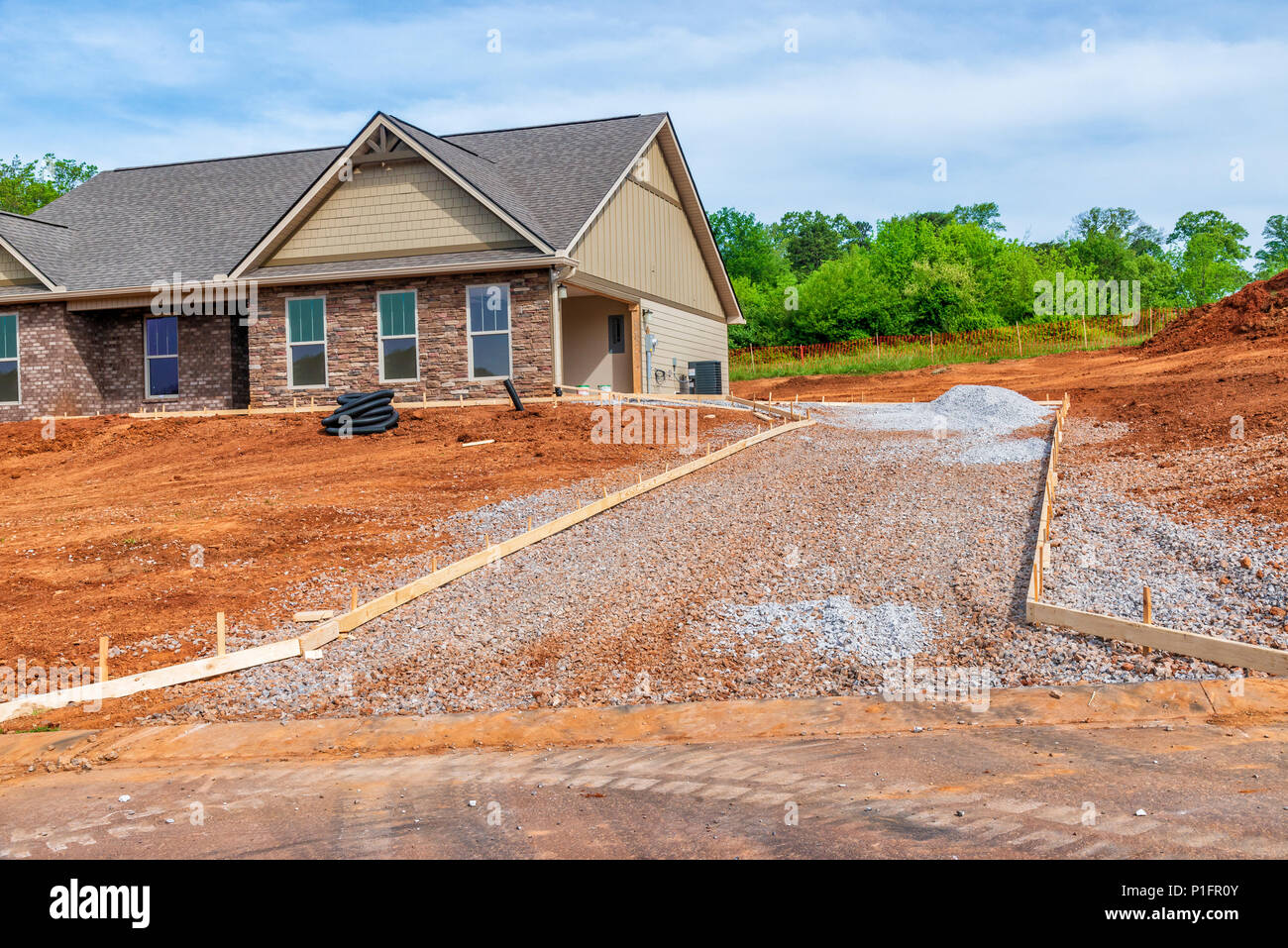 Horiozntal shot of driveway construction on new home. Stock Photo