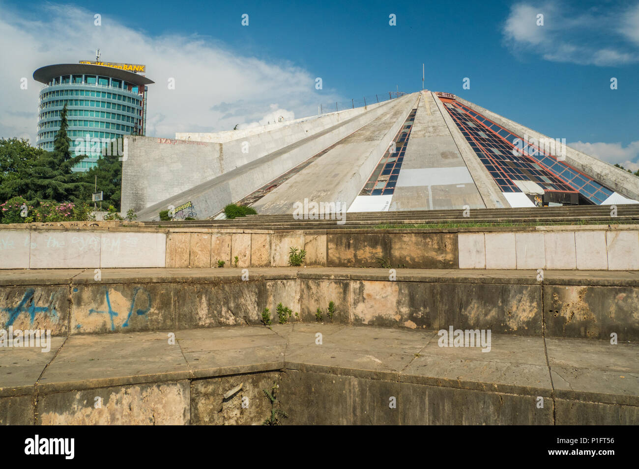People having fun at the 'Pyramid' of Tirana, an unusual building and formerly the Enver Hoxha Museum. Albania - Stock Image