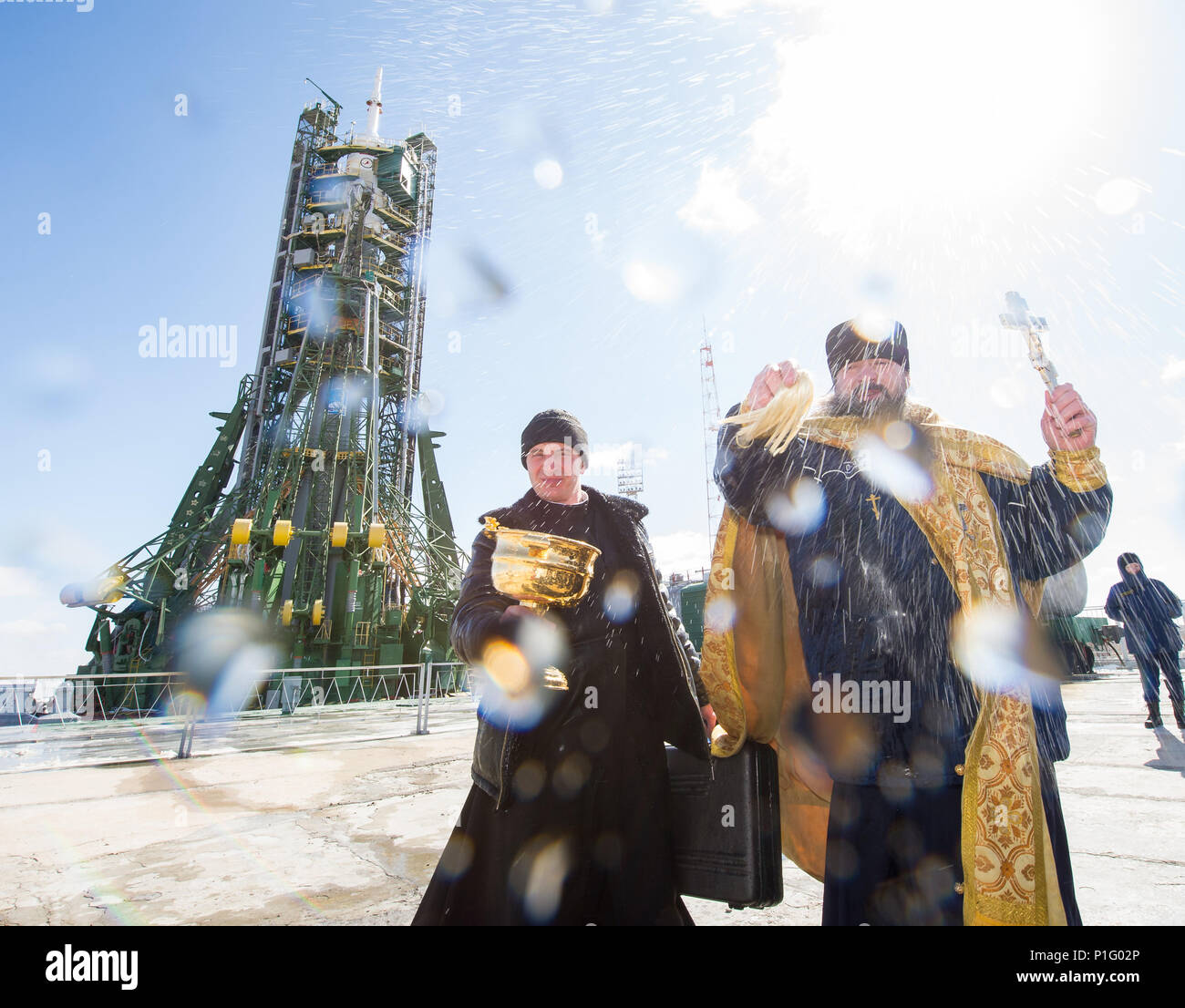 An Orthodox priest blesses members of the media at the Baikonur Cosmodrome launch pad on Thursday, March 17, 2016 in Kazakhstan.  Launch of the Soyuz rocket. - Stock Image