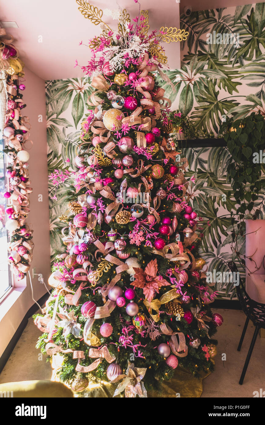 Christmas Tree With Pink And Gold Ornaments Stock Photo Alamy