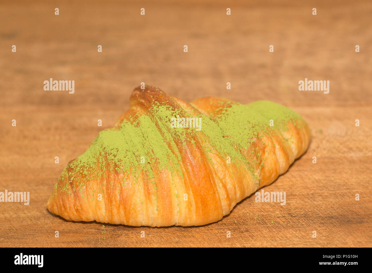 Fresh matcha croissant - Stock Image