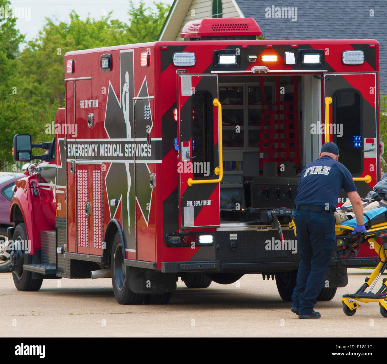 BOSSIER CITY, LA., USA - APRIL 10, 2017: An EMT prepares to place a patient in an ambulance. - Stock Image