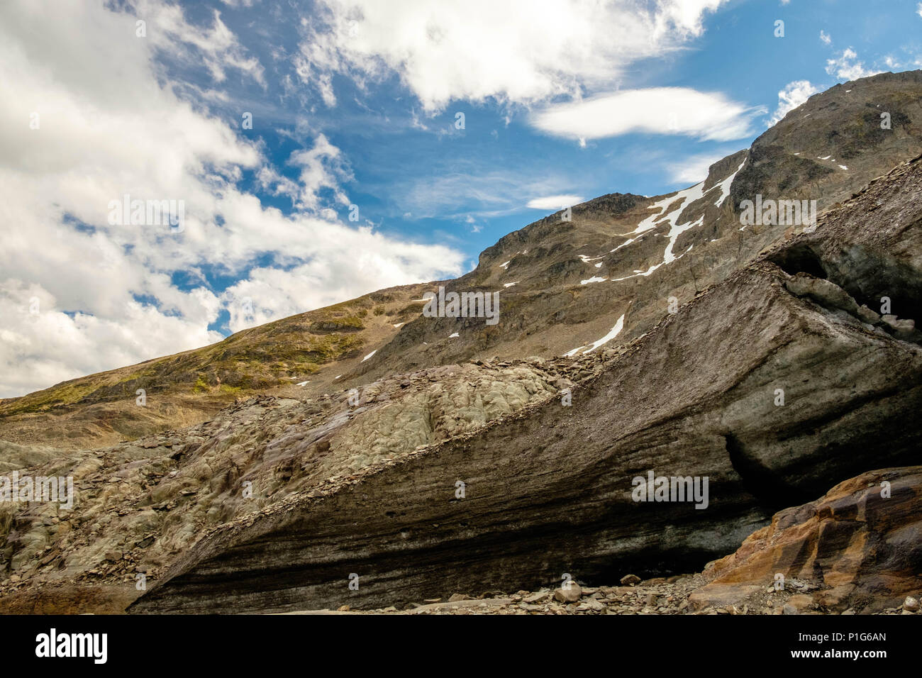 A small cave shows up near the Laguna de los Témpanos, a stunning mountain lake close to Ushuaia, the southernmost city of the world. Stock Photo