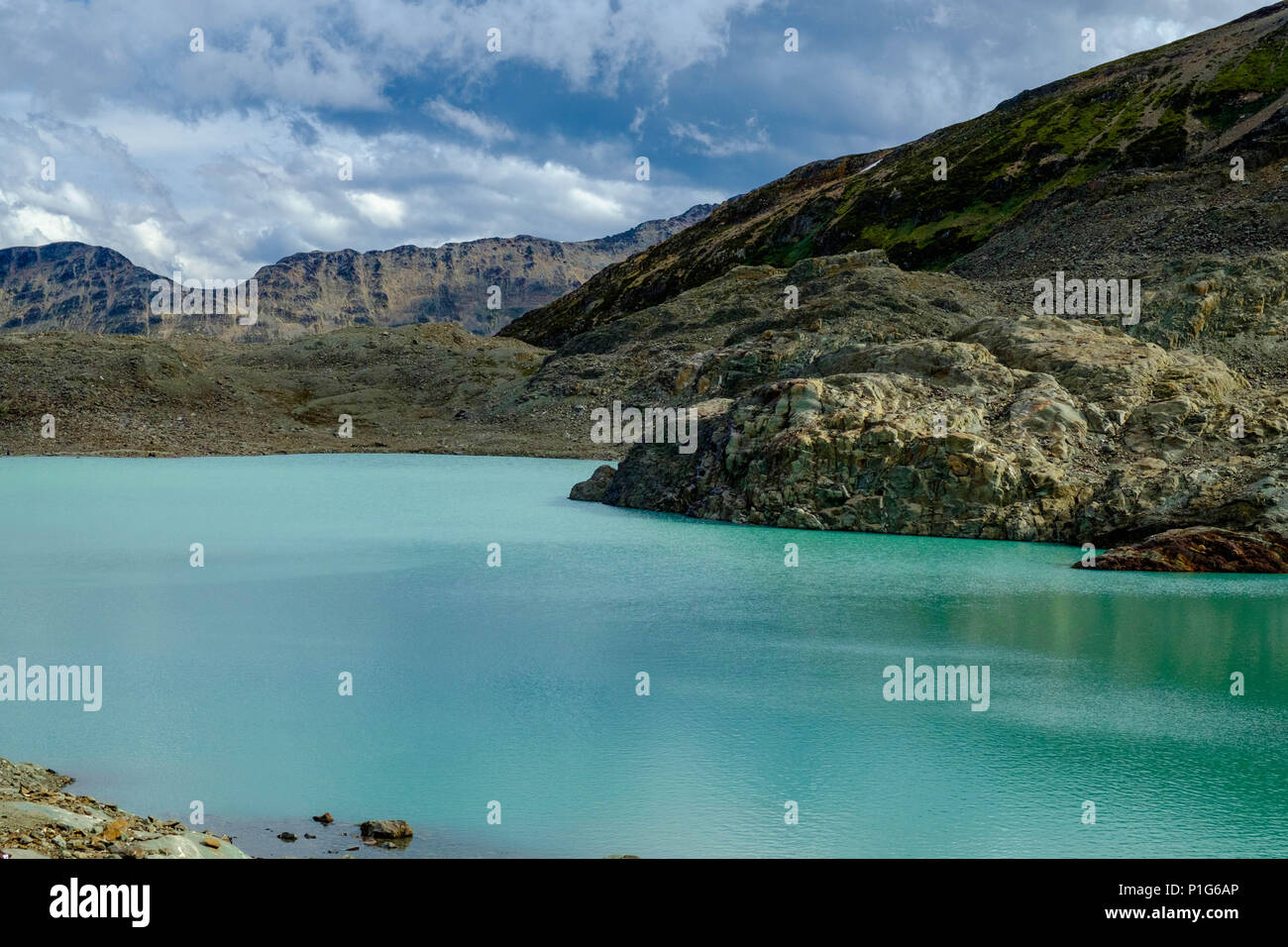 The 'Laguna de los Témpanos' is one of the most fascinating mountain lakes near Ushuaia. With the colours and rocks, it seems to be another planet. Stock Photo