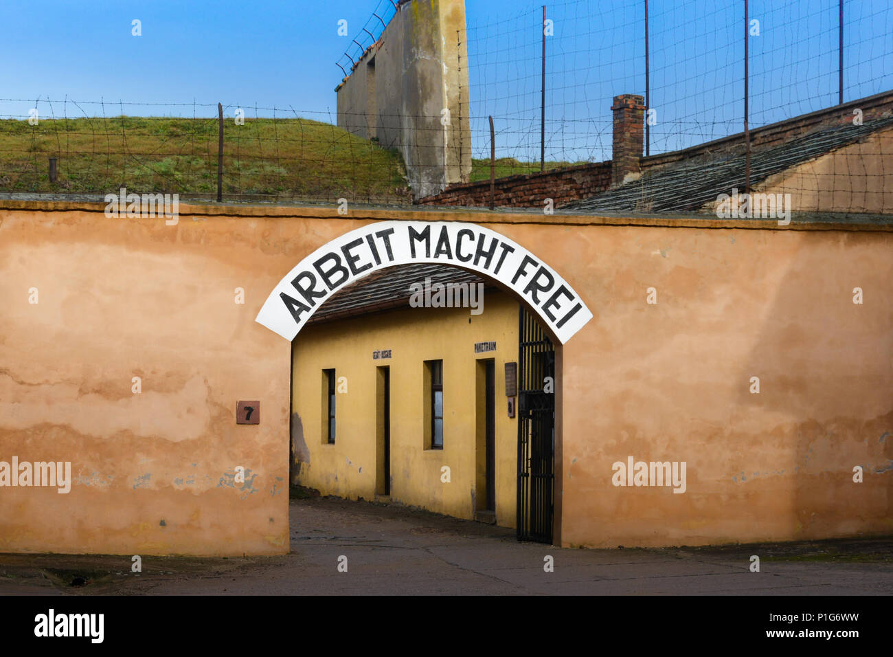 Terezin (Theresienstadt) Concentration Camp with Arbeit Macht Frei sign at the entrance. - Stock Image