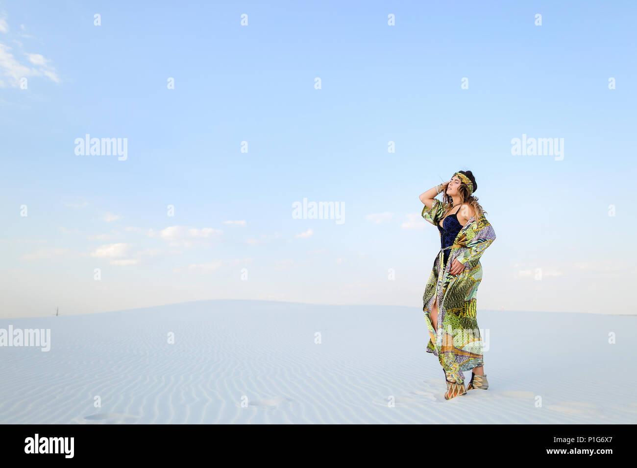 Caucasian stylish female person wearing green beach robe and swi - Stock Image
