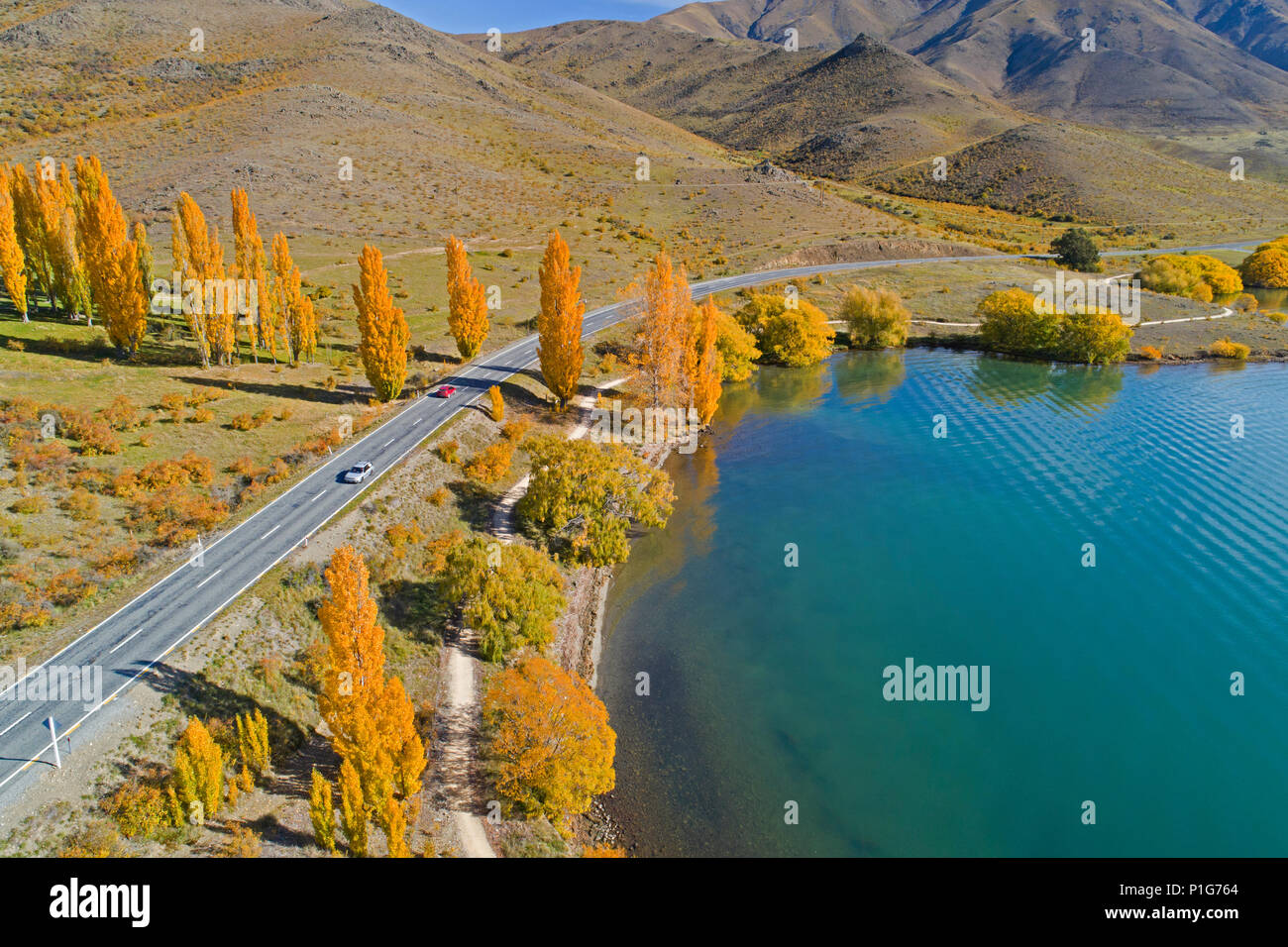Highway and Alps 2 Ocean Cycle Trail, and Lake Benmore, Waitaki Valley, North Otago, South Island, New Zealand - drone aerial - Stock Image