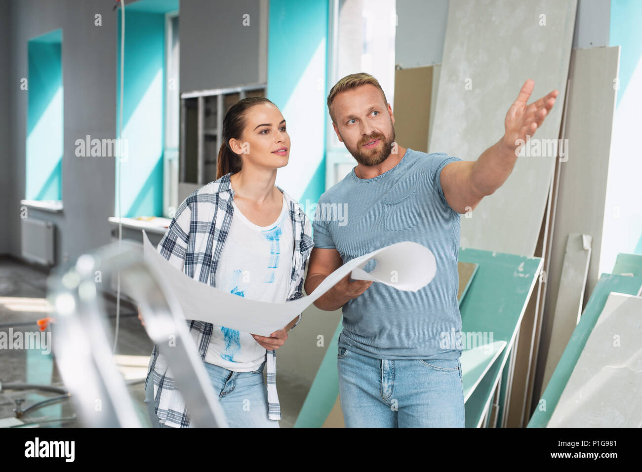 Serious man telling his preferences in renovations - Stock Image