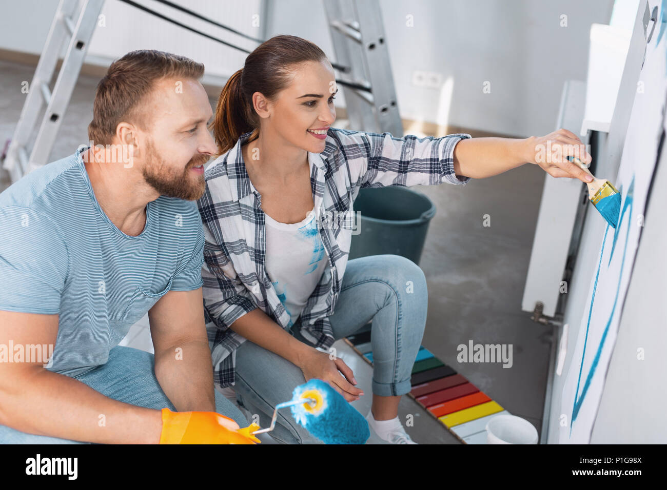 Inspired woman painting a heart for her man - Stock Image