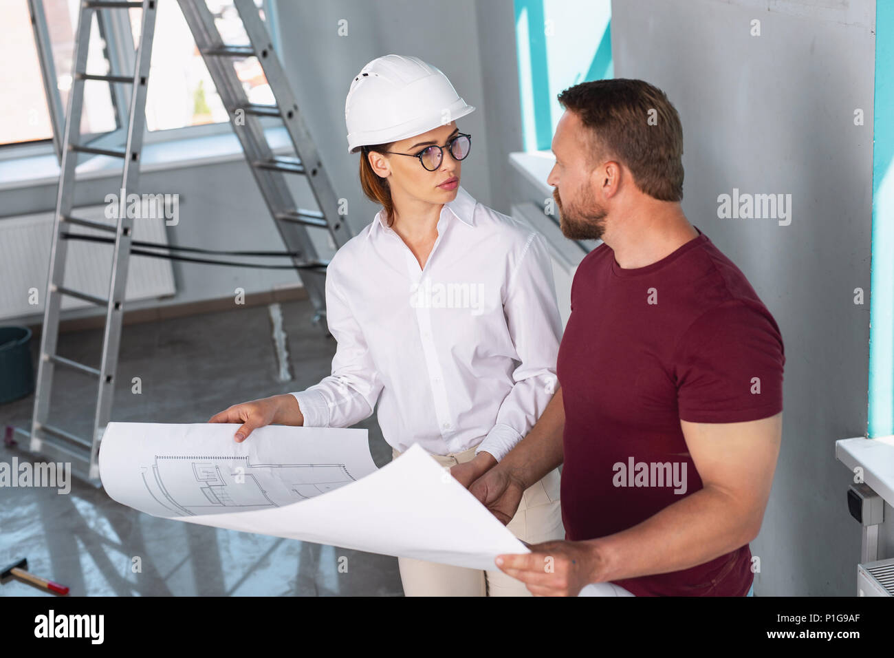 Attentive designer and client talking about the project - Stock Image