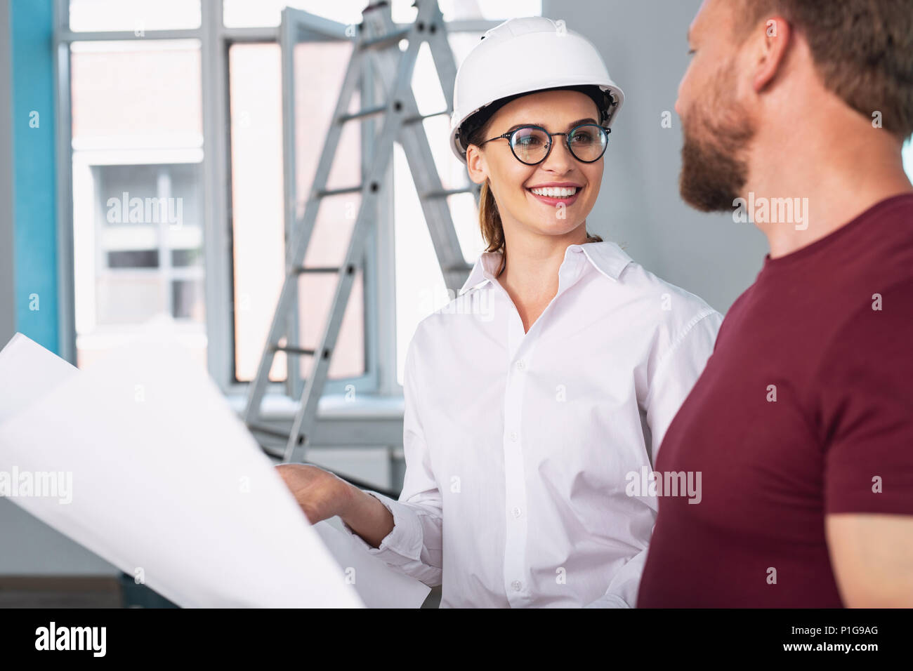 Cheerful designer and client talking about the project - Stock Image
