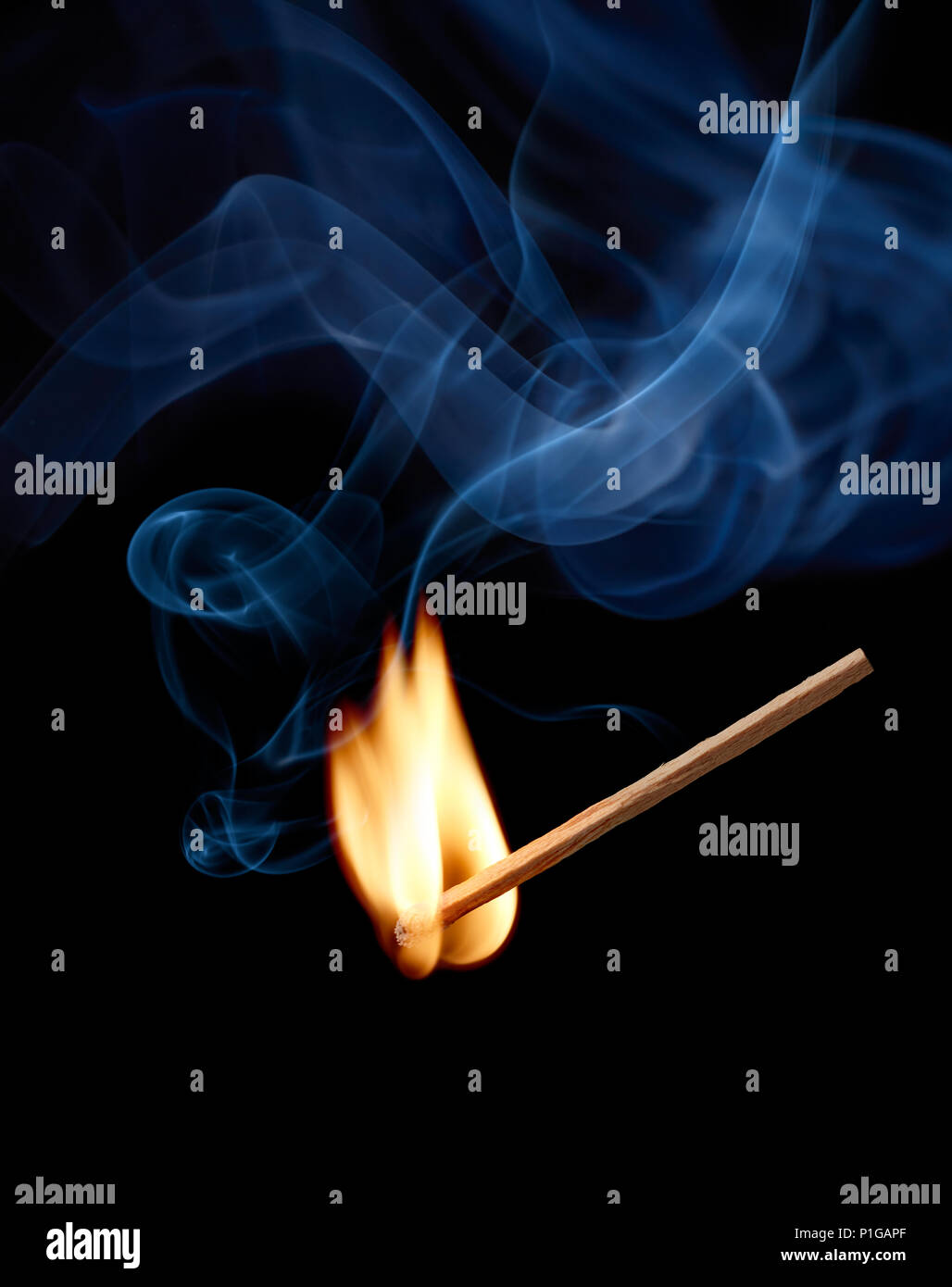 matchstick with flame and smoke at the moment of ignition - Stock Image