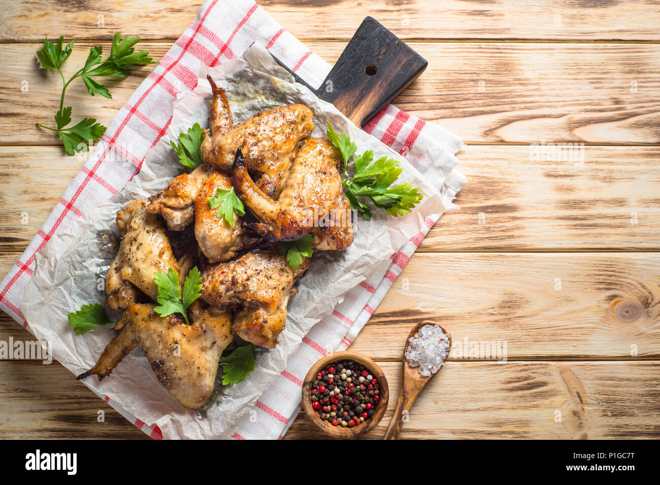 Fried chicken wings of barbecue on wooden table. Top view with copy space. - Stock Image