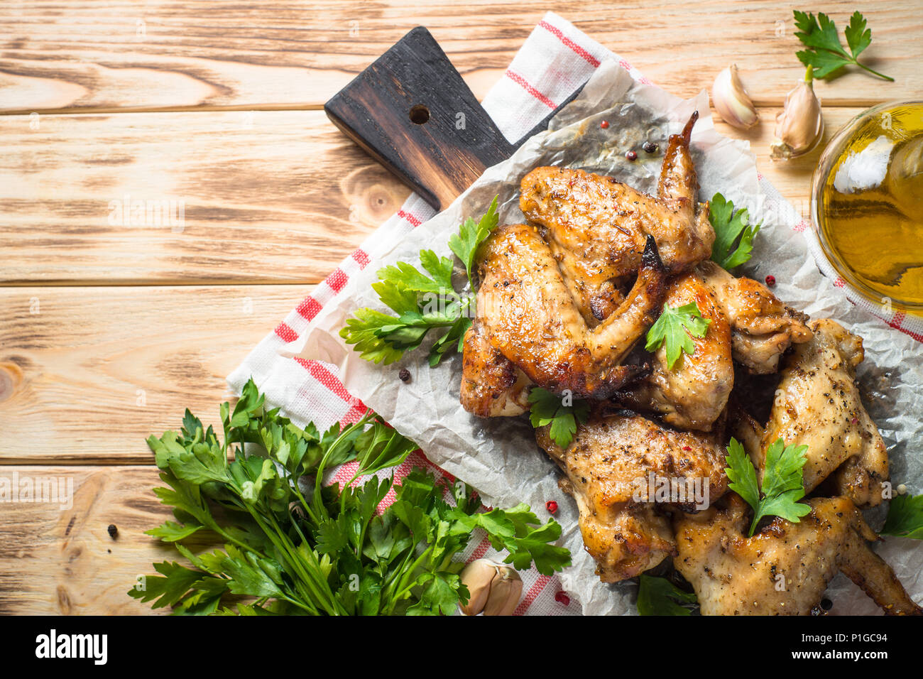 Baked chicken wings. Fried chicken of barbecue on wooden table. Top view copy space. - Stock Image