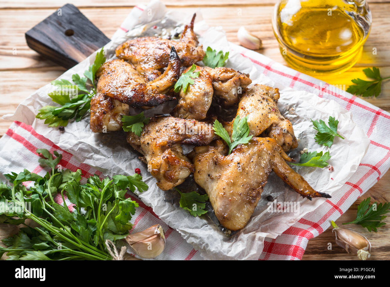 Fried chicken wings of barbecue on wooden table. Stock Photo