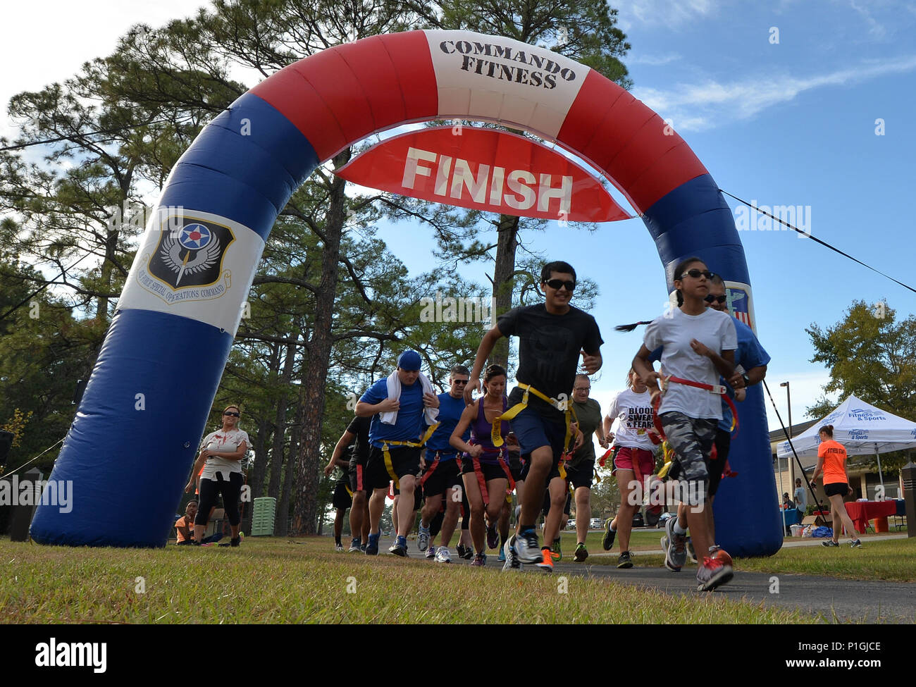 "Air Commandos begin the Fear the Running Dead Race at Hurlburt Field, Fla., Oct. 27, 2016. During the race, runners were challenged to ""survive the apocalypse"" by avoiding zombified Airmen for close to 3.1 miles. (U.S. Air Force photo by Senior Airman Andrea Posey) - Stock Image"