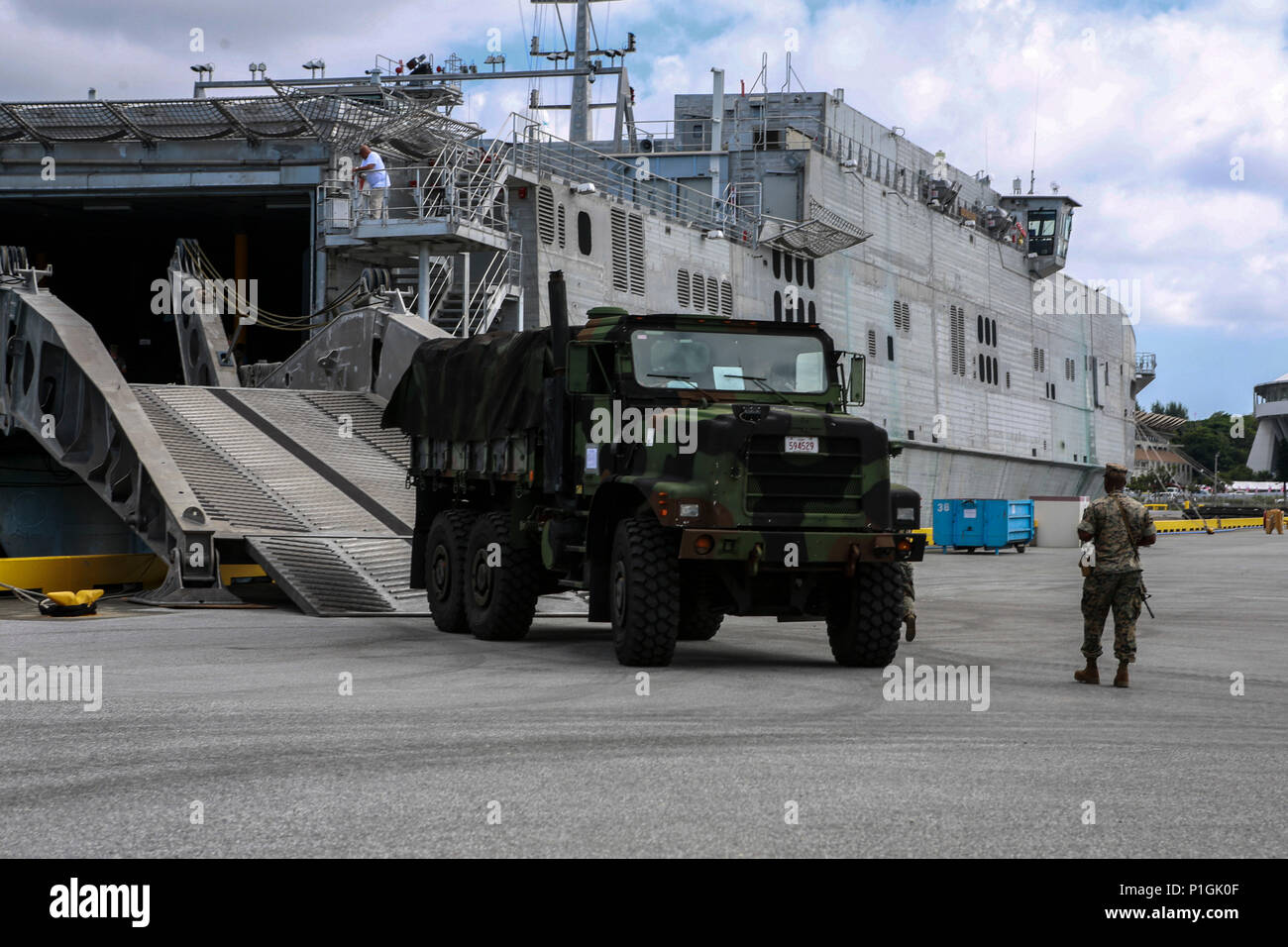 U.S. Marines with Truck Company, 3rd Marine Division, Headquarters Battalion, III Marine Expeditionary Force embark the USNS Fall River (T-EPF-4) at Naha Port, Okinawa, Japan during Blue Chromite 2017, October 28, 2016. Blue Chromite is a U.S. – only exercise which strengthens the Navy-Marine Corps expeditionary, amphibious rapid-response capabilities based in Okinawa and the greater Indo-Asia-Pacific region. (U.S. Marine Corps photo by MCIPAC Combat Camera Lance Cpl. Tiana Boyd) - Stock Image