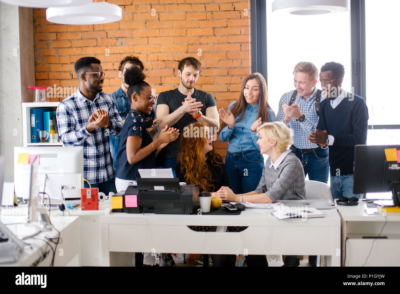 office workers are warmly greeting and welcoming new partner - Stock Image