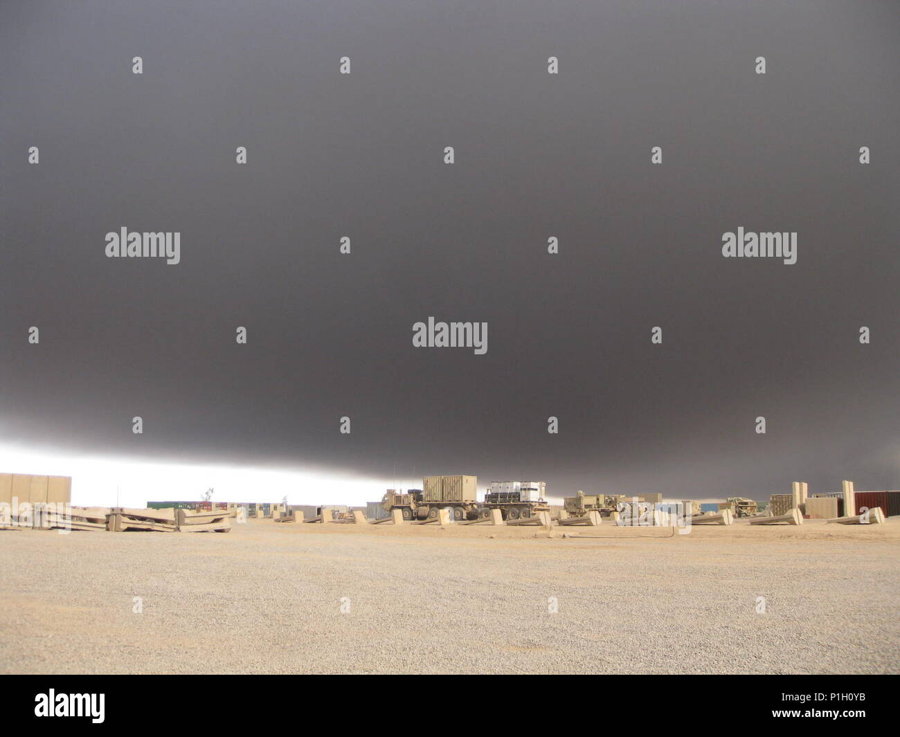 Sulphur dioxide from a fire at the Al-Mishraq sulfur plant travels over Qayyarah Airfield West, Iraq, Oct. 25, 2016. Marines with an Advise and Assist Team with the Special Purpose Marine Air-Ground Task Force-Crisis Response-Central Command were deployed to the area when the fire was burning. The Marines of the A&A Team were able to overcome these conditions and continue operating due to their CBRN training. U.S. Marines receive this training throughout their careers and before deploying in order to effectively respond to an attack and continue accomplishing the mission. - Stock Image