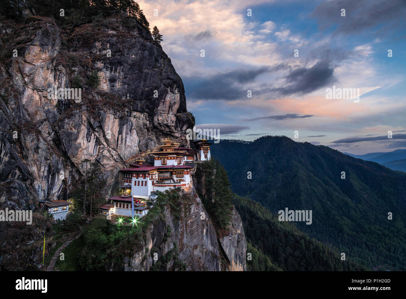 The famous Tiger's Nest monastery of Paro Taktsang at sunset in Bhutan - Stock Image