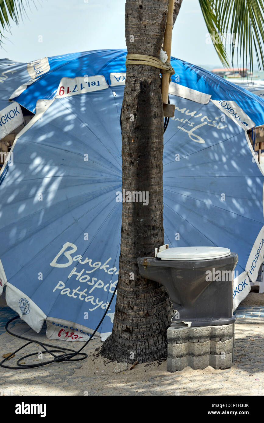 Amusing street placement of a discarded toilet seat at Pattaya Thailand Southeast Asia - Stock Image
