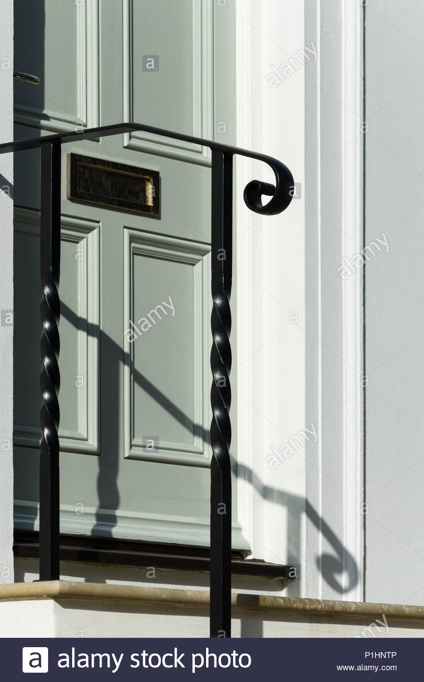 Looking at a house letter box through the handrail to the front door ...