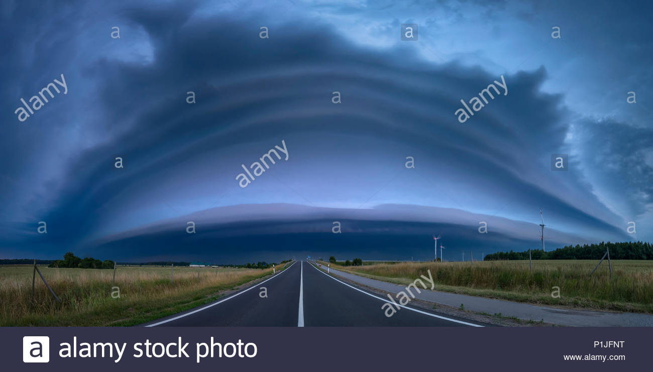 Panorama of a shelf cloud during an approaching thunderstorm in the blue hour on June 24th 2016, Grimmen, Mecklenburg-Vorpommern, Germany - Stock Image