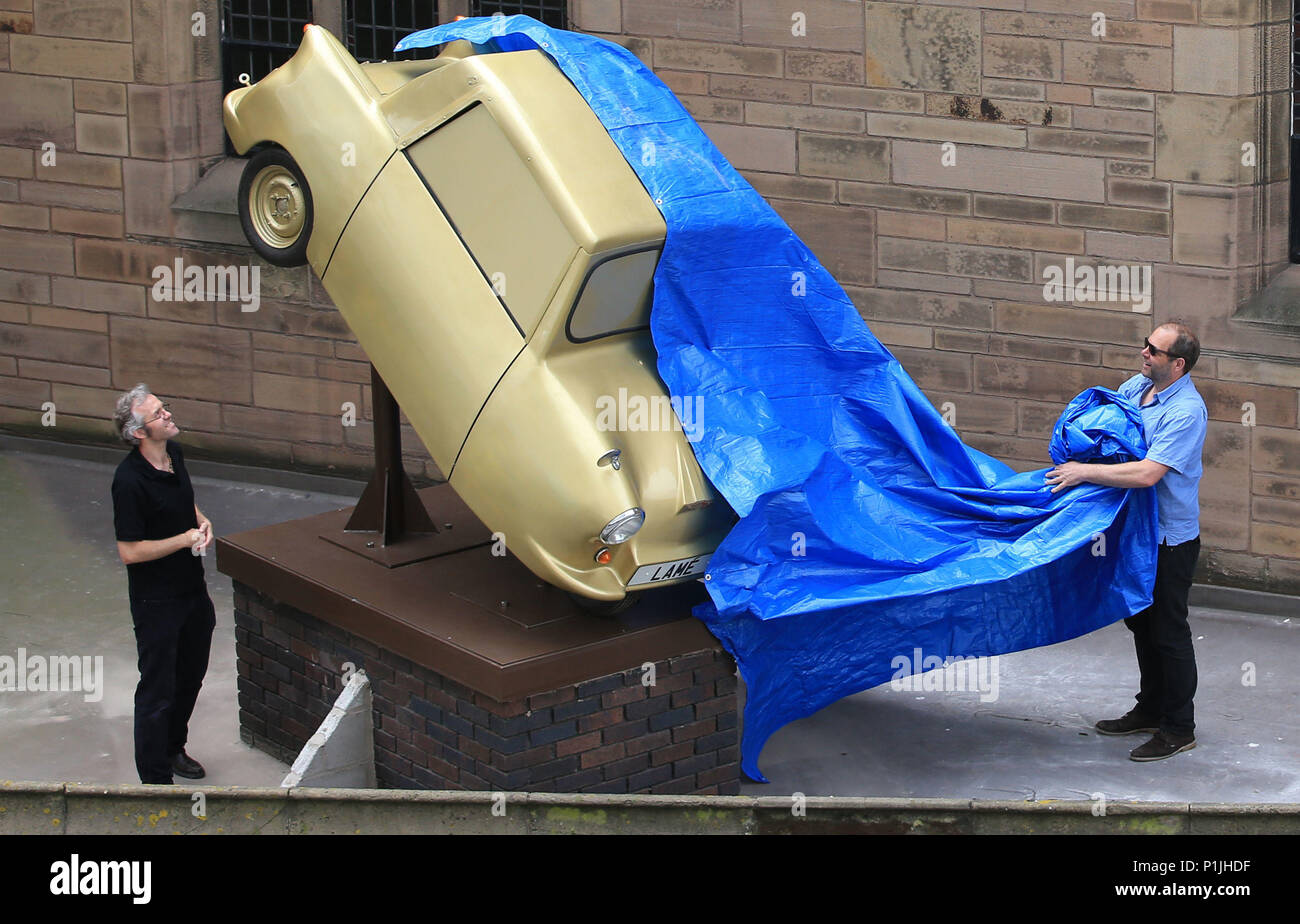Gold Lame, an art installation by disabled artist Tony Heaton, is unveiled on a plinth in Liverpool's St Nicholas Church Gardens. The fibreglass and steel sculpture, which depicts an Invacar like the one the artist was issued with in the 1970s, aims to challenge perceptions of disability. - Stock Image