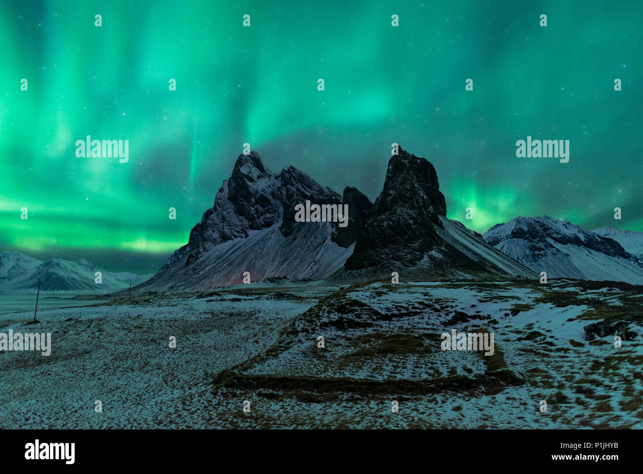 Northern Lights over Eystrahorn, Krossanesfjall, Iceland - Stock Image