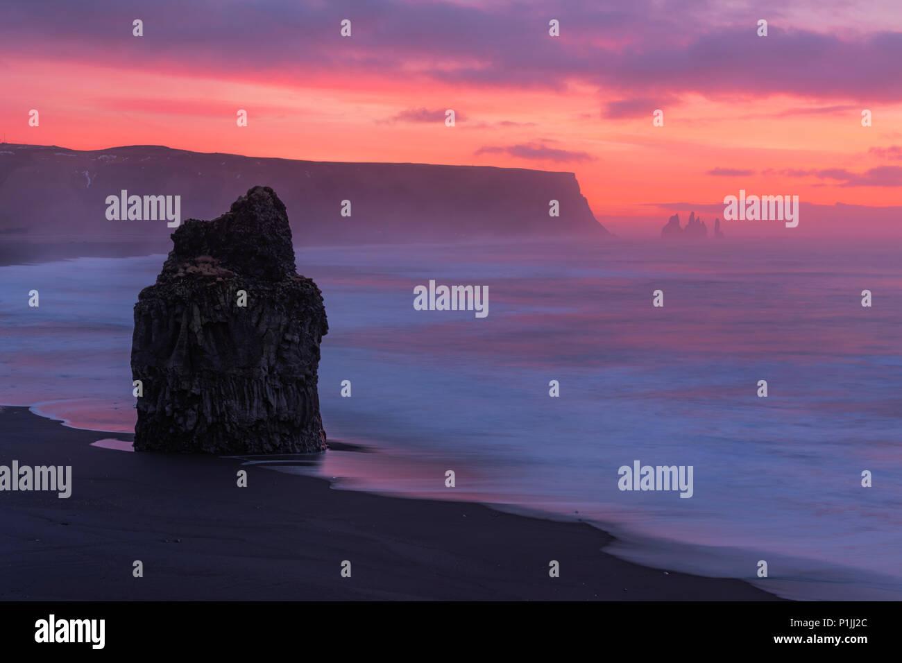 Dawn on the beach at Reynisfjara, Vik, Iceland - Stock Image