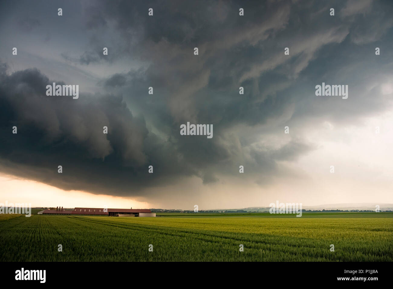 Backside of a dynamic thunderstorm near Inheiden, Hessia, Germany - Stock Image