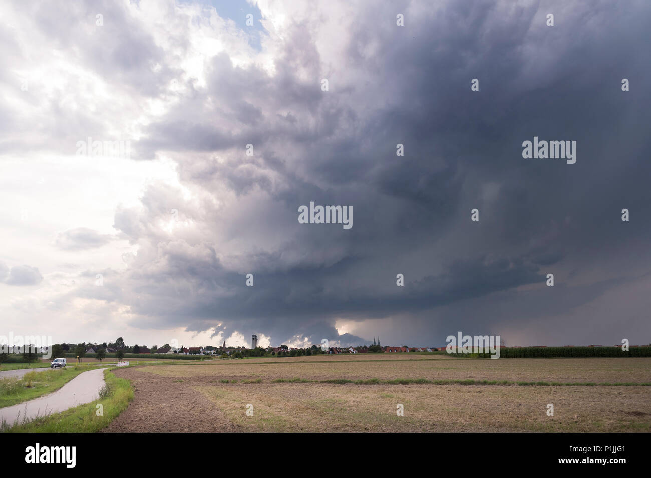 Storm split of two supercells, two wall clouds visible in the fore- and background, near Heilsbronn, Bavaria, Germany - Stock Image