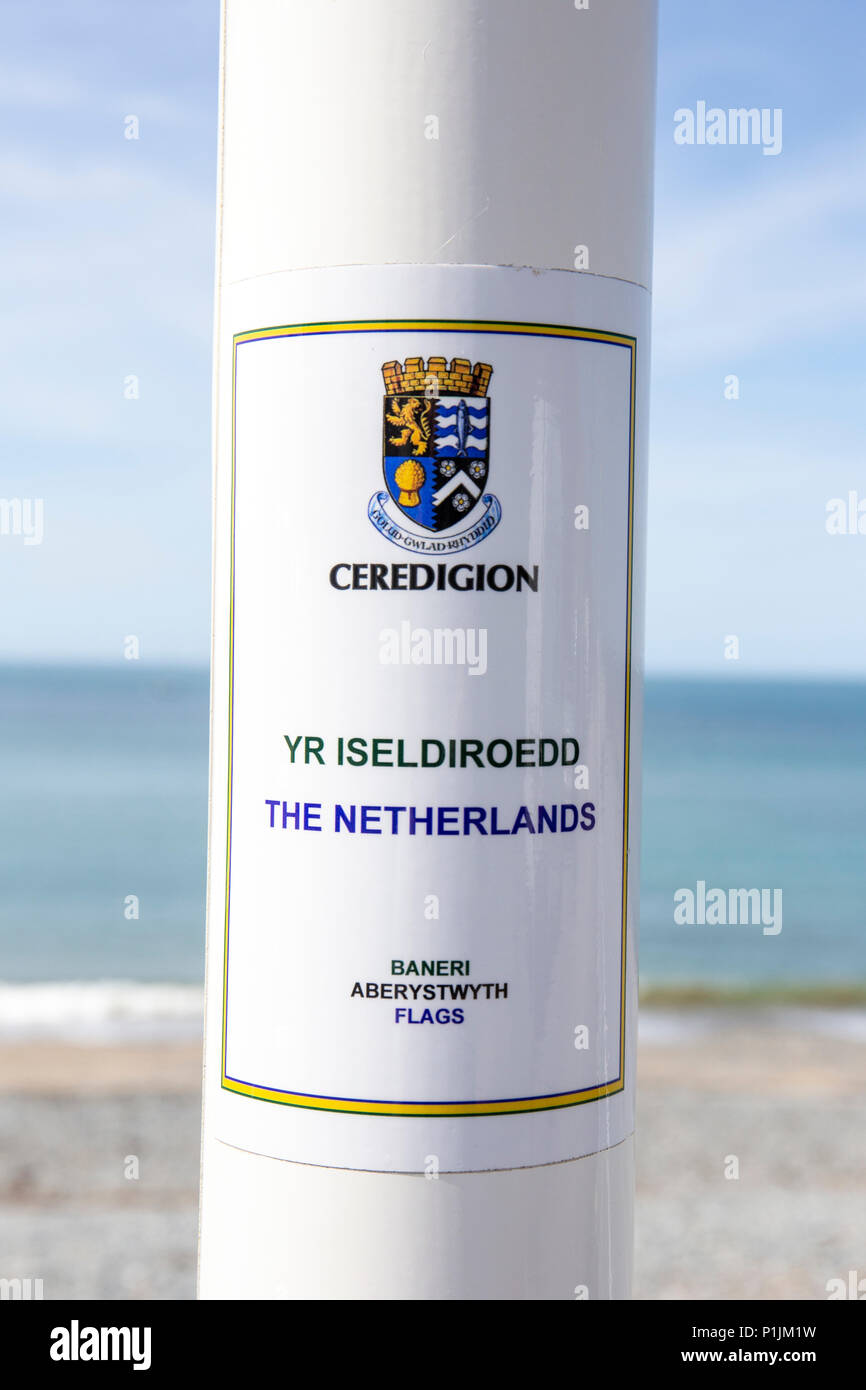 Flagpole The Netherlands, Yr Iseldiroedd, on the promenade in Aberystwyth Ceredigion Wales UK - Stock Image
