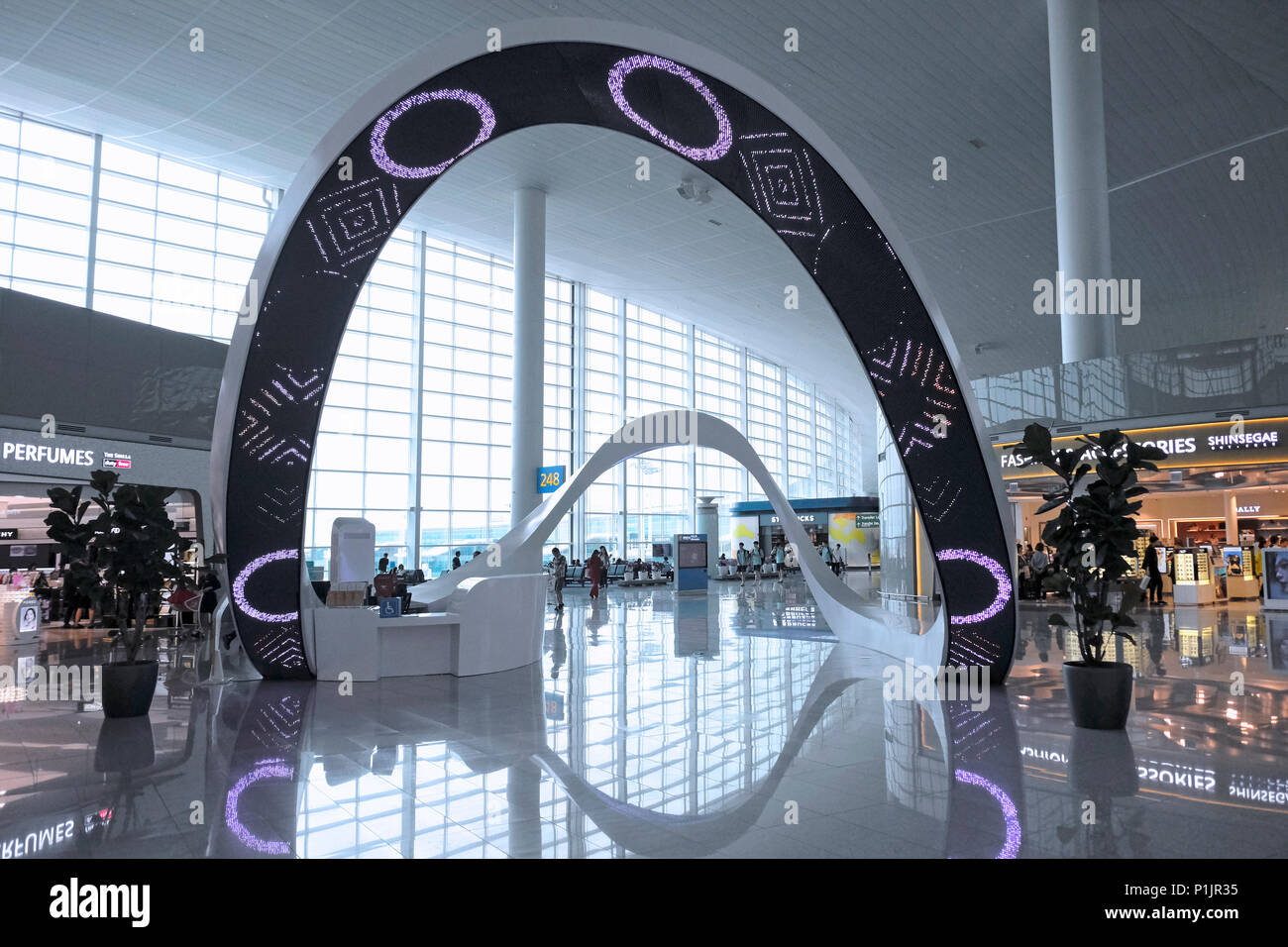 b1a62b4783c A loop-shape structure that plays multiple roles of media art at the Duty  free shops ...