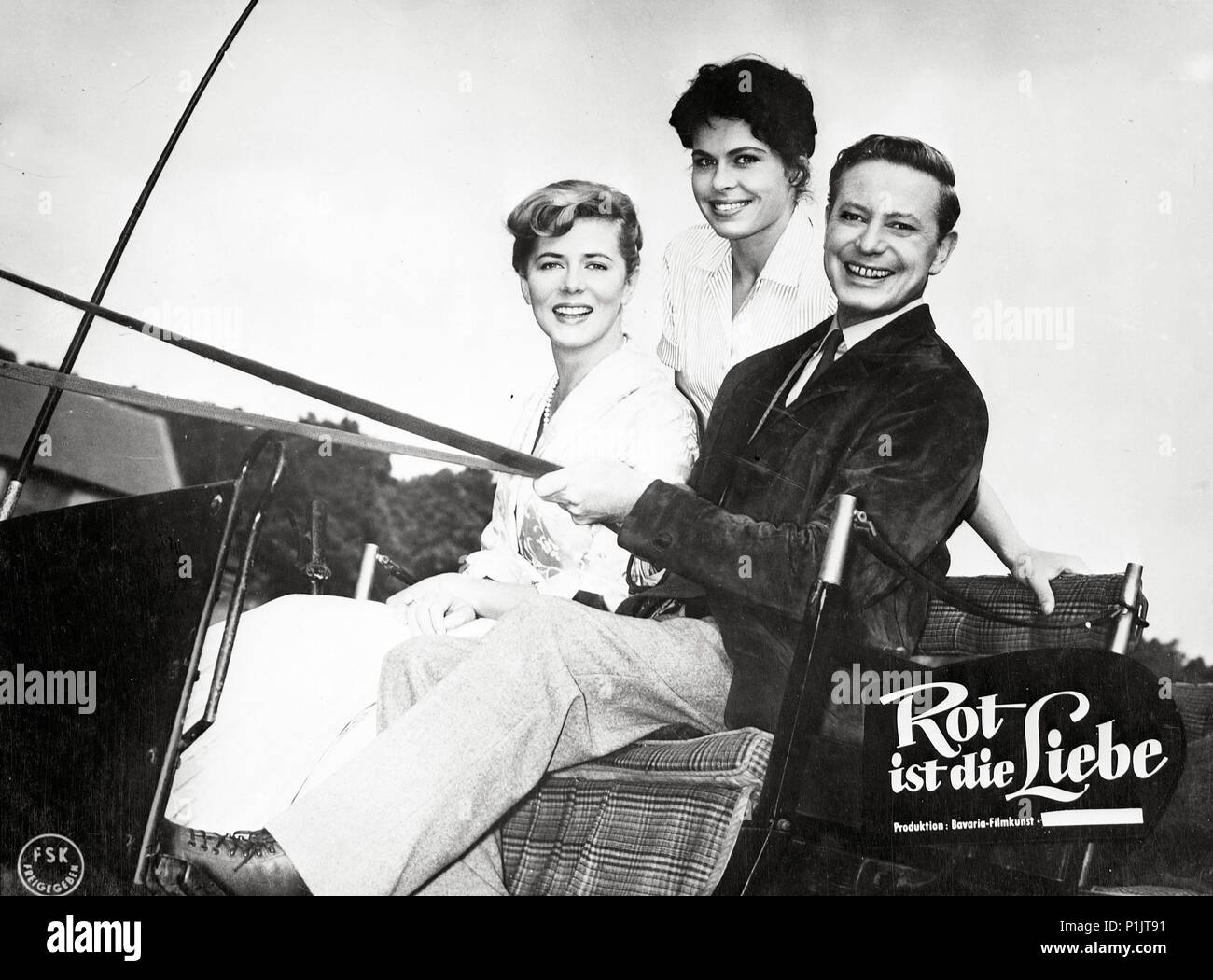 Original Film Title: ROT IST DIE LIEBE.  English Title: ROT IST DIE LIEBE.  Film Director: KARL HARTL.  Year: 1957.  Stars: DIETER BORSCHE; CORNELL BORCHERS; BARBARA RUTTING. - Stock Image