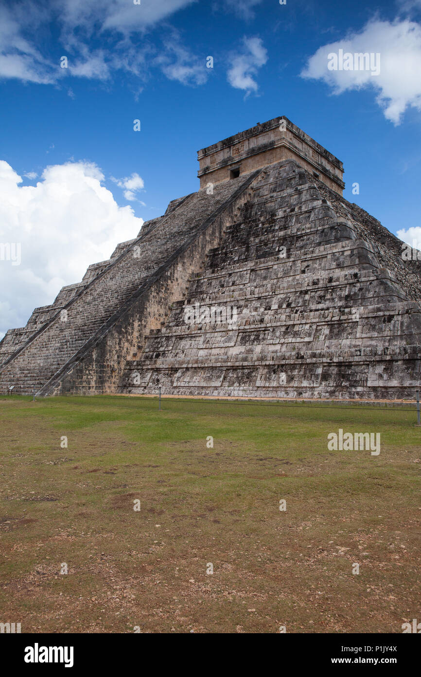 Majestic ruins in Chichen Itza,Mexico.Chichen Itza is a complex of Mayan ruins. A massive step pyramid, known as El Castillo or Temple of Kukulcan, do - Stock Image