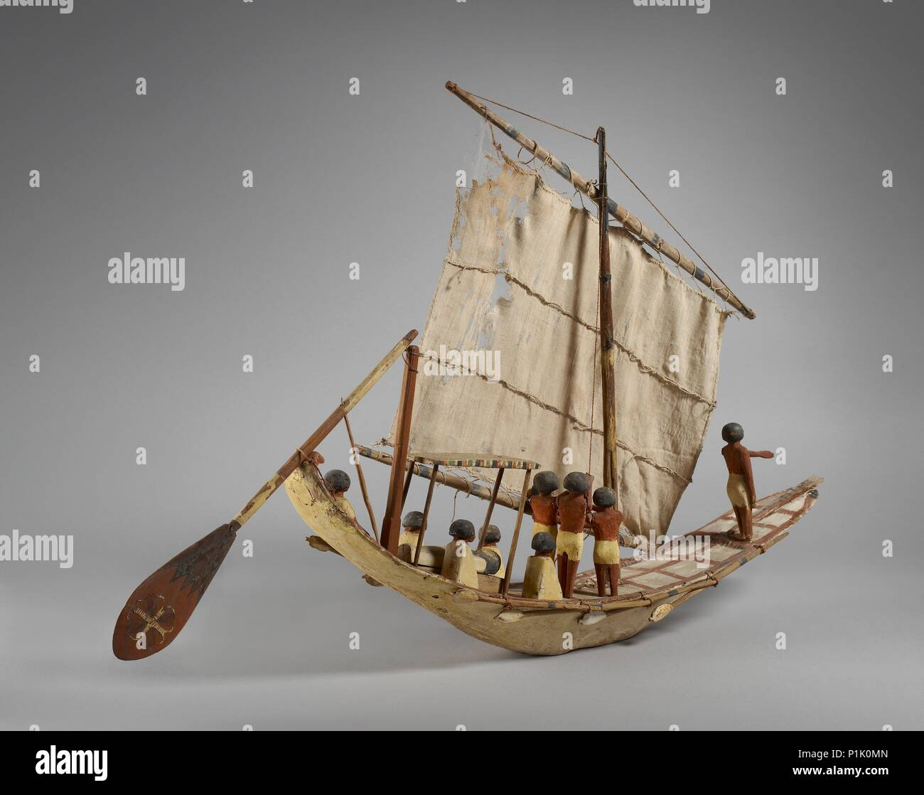Model of a boat, Middle Kingdom, c1975- 1640 BC. Model boat with sail, oars and 10 figures, painted decoration. Dimension: length: 71.5 cm - Stock Image