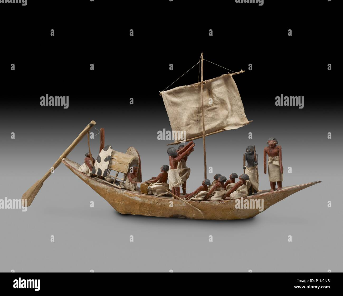 Model of boat, IXth - XIth Dynasty, c2125 -c1940 BC. Model war boat with sail, oars and 14 figures, painted decoration. Dimension: length: 93 cm - Stock Image