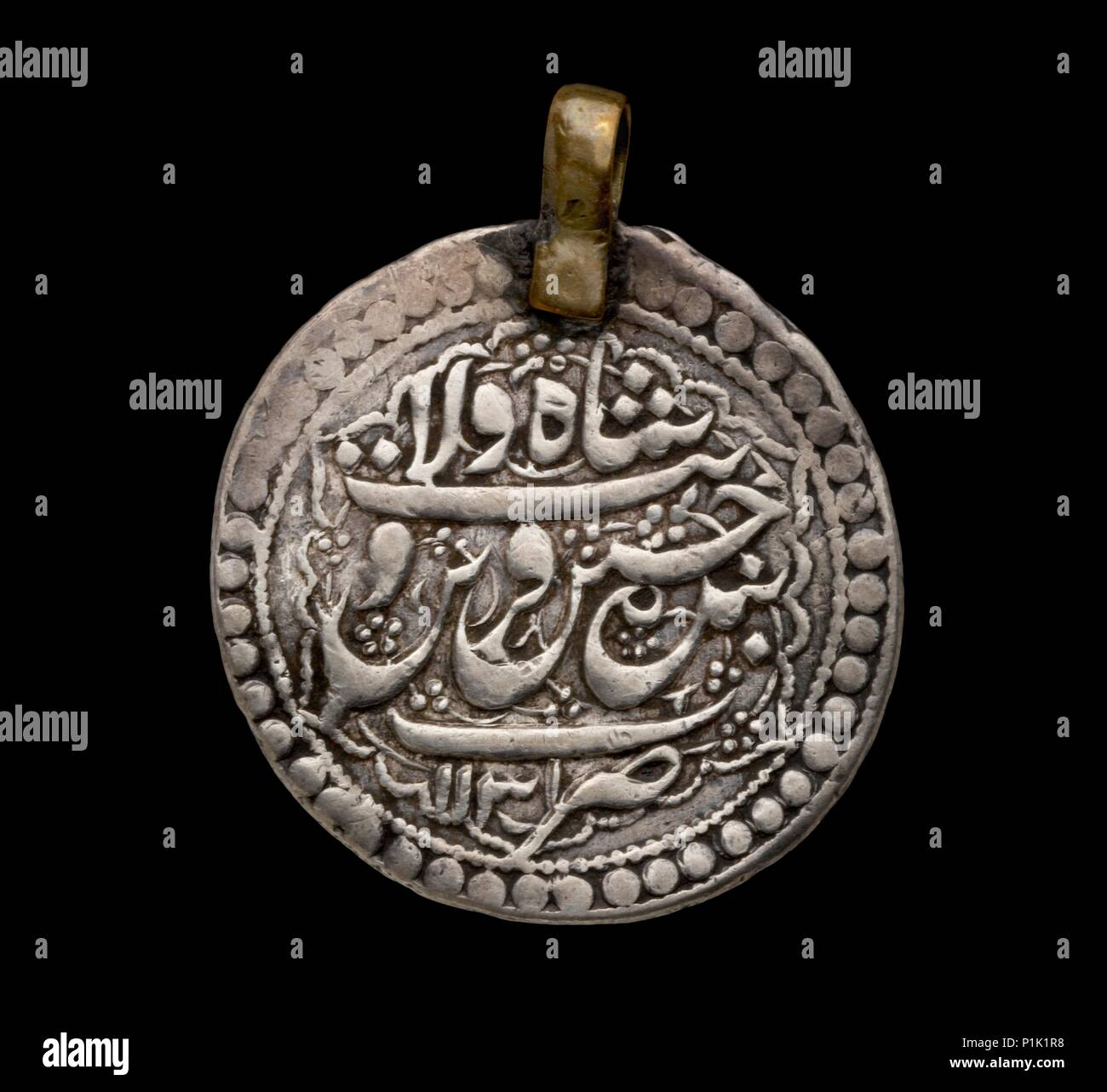 Islamic Coin, early 18th century.  Dimension: diameter: 27 mmweight: 5.52 g - Stock Image