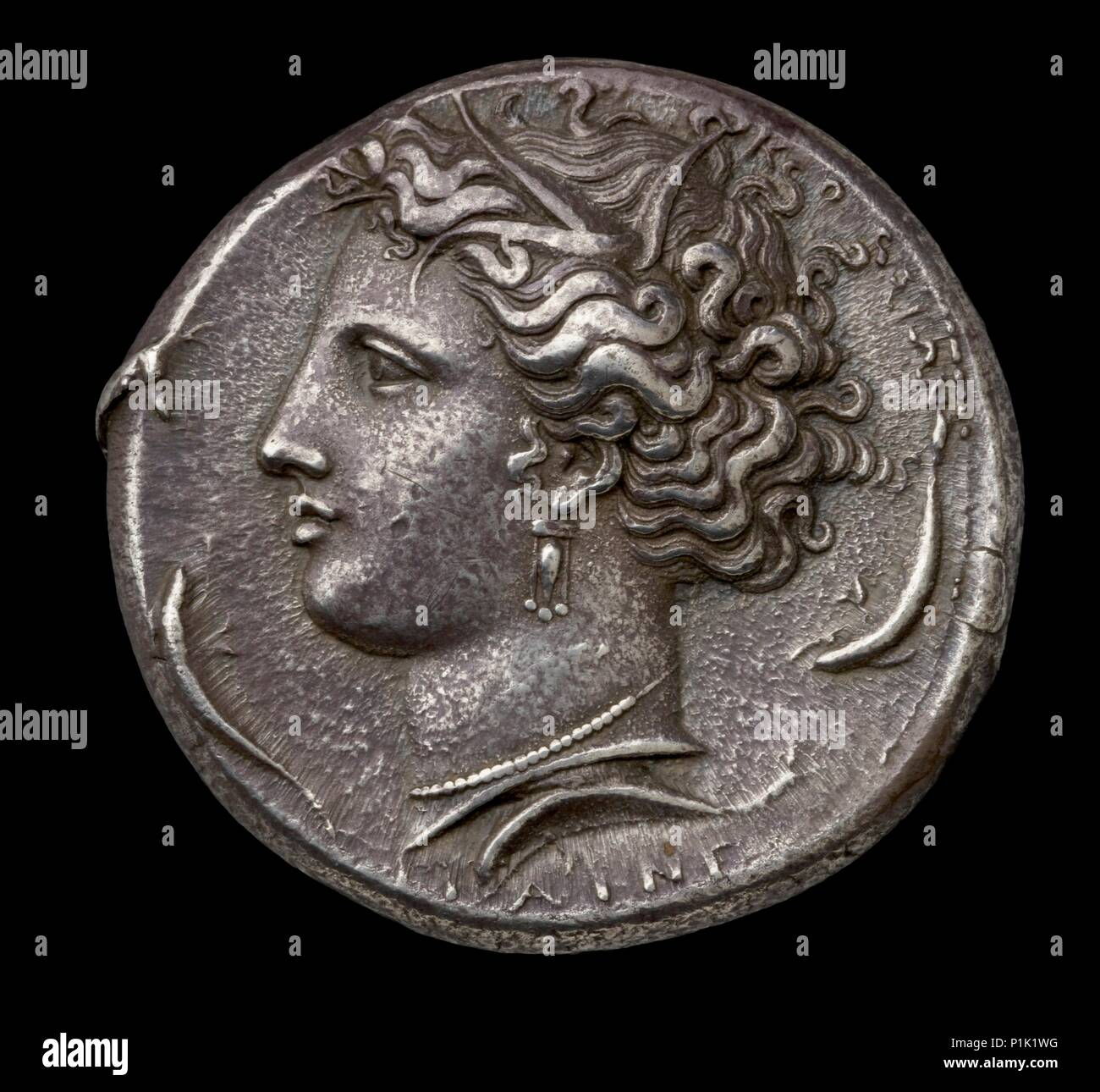 Ancient Greek silver coin, 404 BC / 390 BC.  Dimension: diameter: 40 mmweight: 43.21 gdie-axis: 6 o'clock - Stock Image