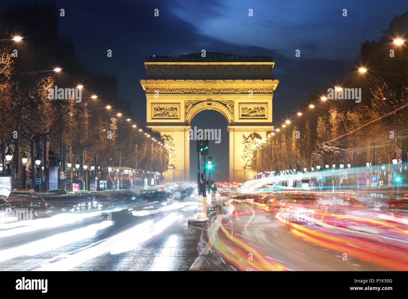 Arc De Triomphe and light trails, Paris - Stock Image