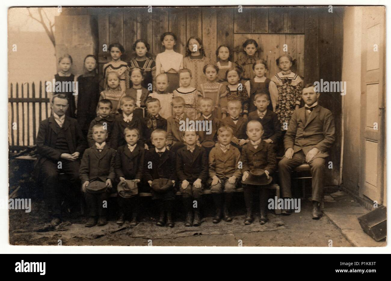 THE CZECHOSLOVAK  REPUBLIC - CIRCA 1930s: Vintage photo shows pupils (schoolmates) and  teachers in the rural back yard.  Black & white antique photography. - Stock Image