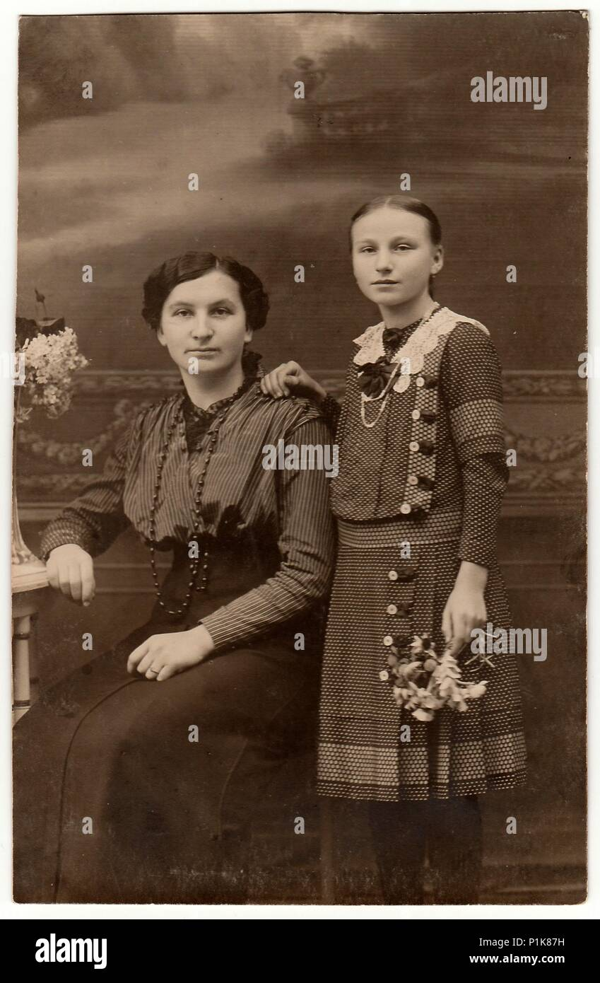 THE CZECHOSLOVAK REPUBLIC - CIRCA 1930s: Vintage studio photo shows mother and daughter. Black & white antique photography. Stock Photo