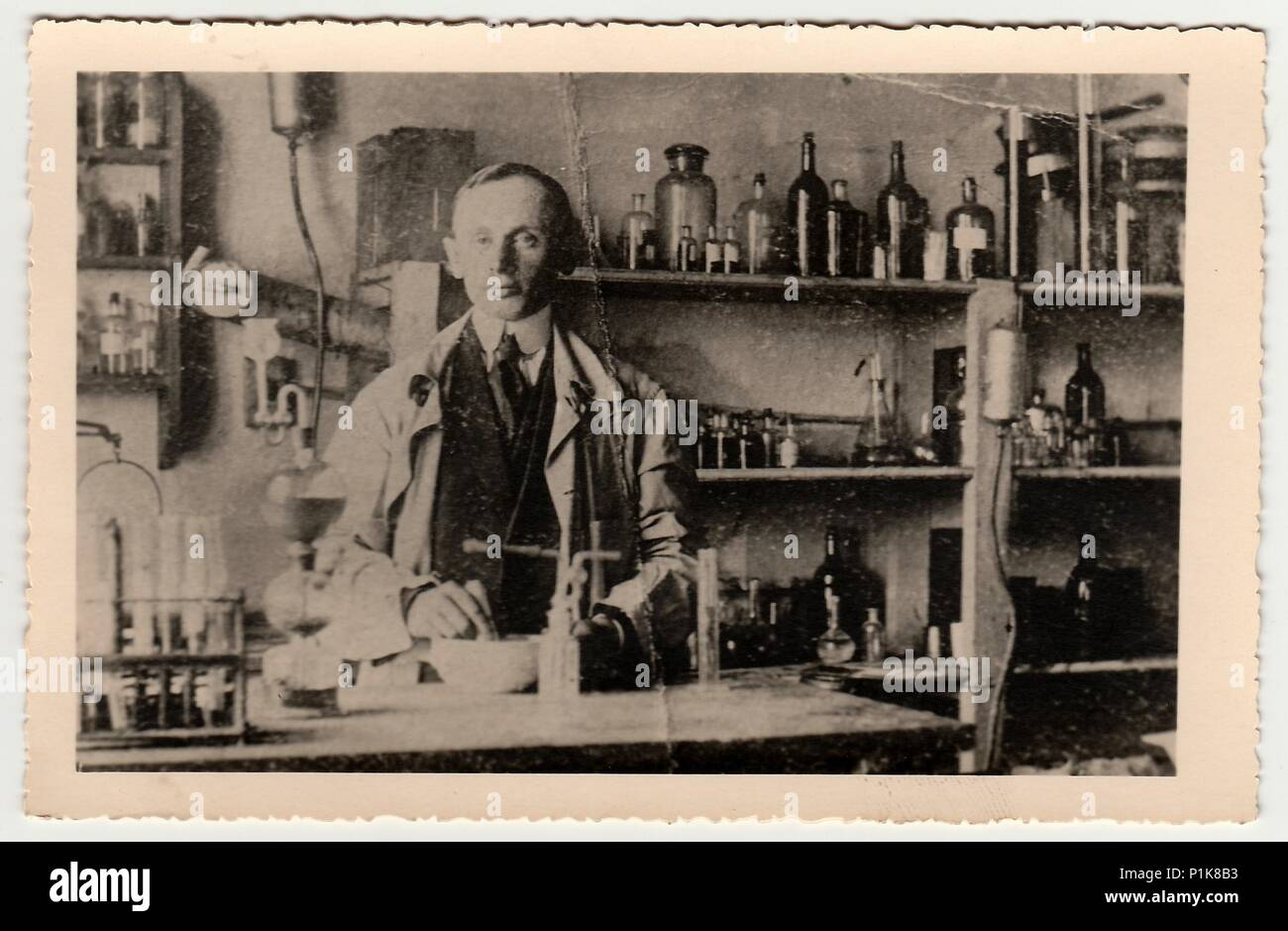 THE CZECHOSLOVAK REPUBLIC - CIRCA 1940s: Vintage photo shows man in the  chemistry laboratory. Black & white antique photography.
