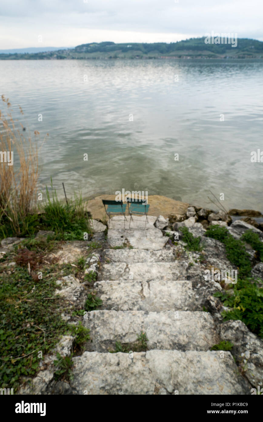 Amazing Two Empty Chairs On The Lake Shore At The Bottom Of Old Pdpeps Interior Chair Design Pdpepsorg