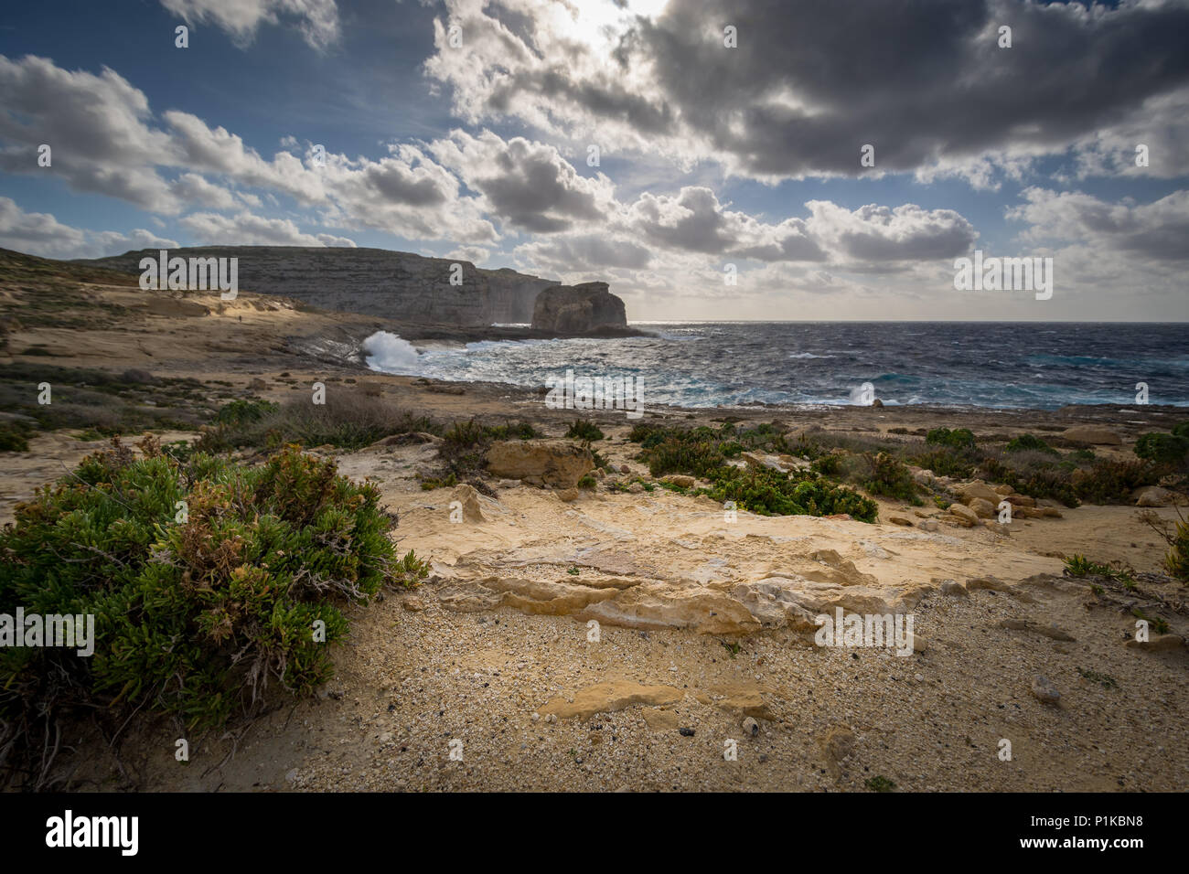 Fungus Rock. Dwejra Bay at the west coast of the Maltese Island of Gozo. Winter, windy day. - Stock Image